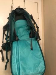Inside the backpack.